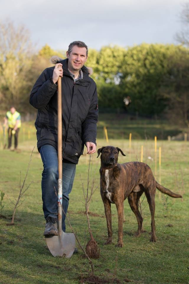 Cllr-Andy-Stafford-plants-trees-at-Perdiswell---with-a-little-help-from-his-dog