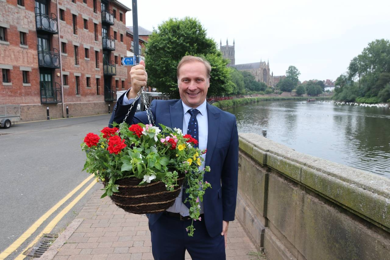 Cllr-Marc-Bayliss-with-one-of-Worcesters-new-floral-display-baskets