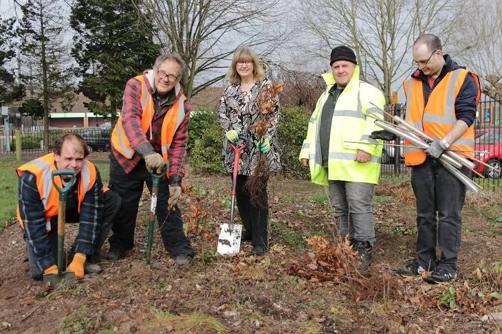 Cllr Joy Squires, centre, meets Taskforce volunteers planting trees in Cripplegate Park