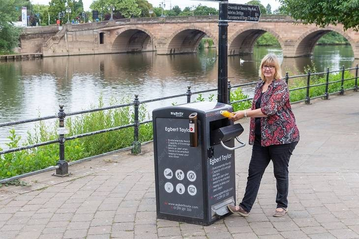 Cllr Joy Squires trying out one of the solar powered bins last summer