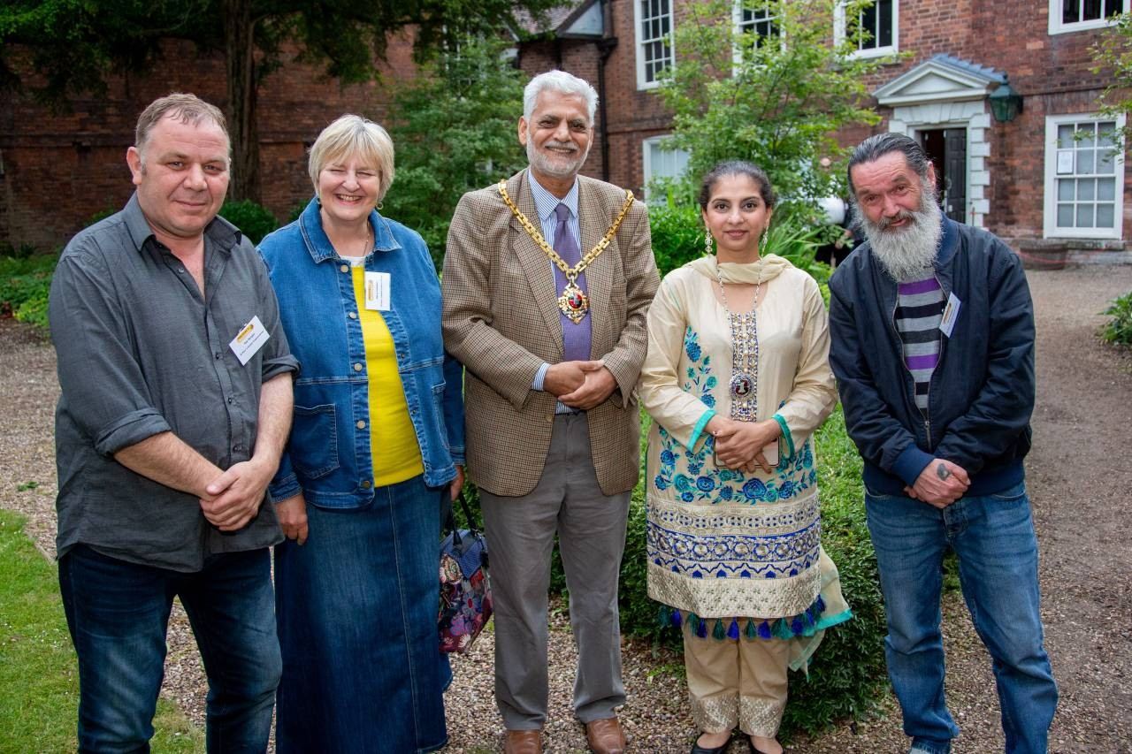 L to R -Volunteers Ray Morgan, Gerry Lowman and Paul Manley from St Paul's Hostel Creative Group with Mayor of Worcester and Consort Parveen Akhtar (centre)
