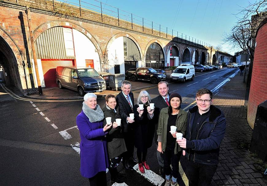 Members of the Worcester Cultural Partnership celebrate the funding announcement at Worcester's Arches