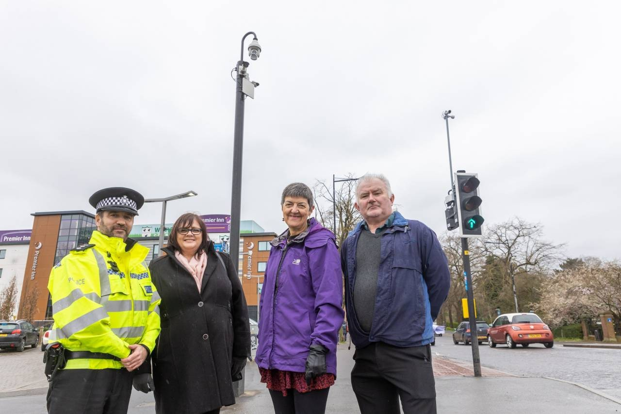 Chief Inspector Gareth Morgan of West Mercia Police; Janet Barrett, Internal Account Manager & Sales support at contractors Tellemachus Ltd; Cllr Lynn Denham, Vice Chair of Worcester City Council's Communities Committee; and Cllr James Stanley, Chair of the Communities Committee in front of the new CCTV camera on Worcester Bridge