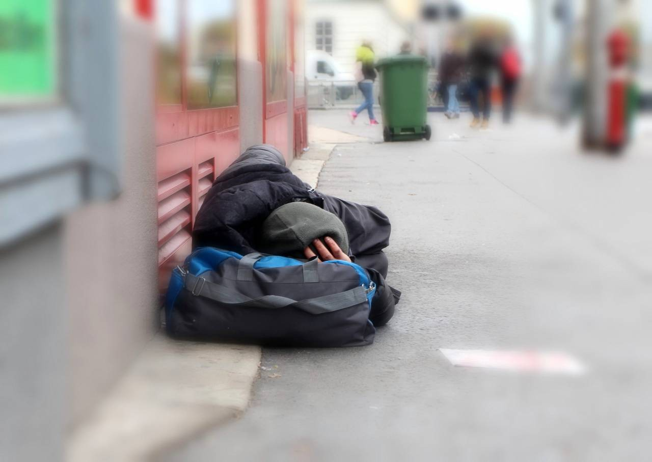A rough sleeper bedding down in the street