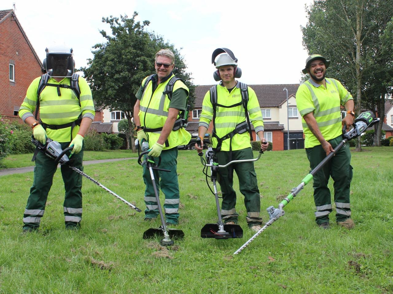 Street-scene-in-action-with-electric-grounds-maintenance-kit-left-to-right-Chris-Davis-Peter-Wright-Alex-Grochotov-Jacob-Newman